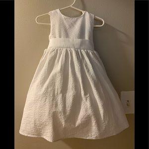 White seersucker dress, flower girl dress.